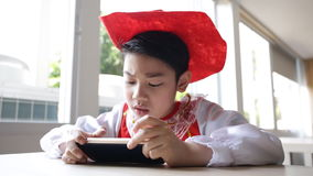 Asian child using a digital tablet . stock footage