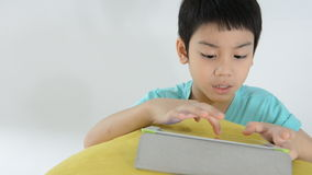 Asian child using a digital tablet . stock video footage