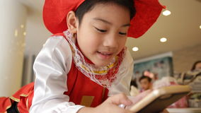 Asian child using a digital tablet . stock video