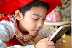 Asian child using a digital tablet together . Royalty Free Stock Photo