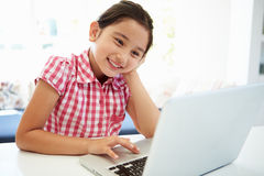 Asian Child Using Laptop At Home Royalty Free Stock Photo