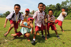 Asian children. RANTEPAO, INDONESIA - JULY 21: Group of children on a football field on July 21, 2011 in Rantepao, Indonesia Stock Image