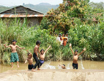 Asian children bath in the river. LAM DONG, VIET NAM- FEB24: Group of Unidentified Asian children have fun at Vietnamese countryside, crowd of boy, girl bath in stock image