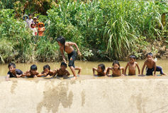 Asian children bath in the river. LAM DONG, VIET NAM- FEB24: Group of Unidentified Asian children have fun at Vietnamese countryside, crowd of boy, girl bath in stock photos