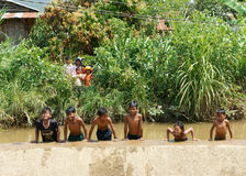 Asian children bath in the river Royalty Free Stock Photos