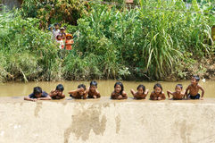 Asian children bath in the river. LAM DONG, VIET NAM- FEB24: Group of Unidentified Asian children have fun at Vietnamese countryside, crowd of boy, girl bath in royalty free stock photography