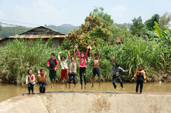 Asian children bath in the river. LAM DONG, VIET NAM- FEB24: Group of Unidentified Asian children have fun at Vietnamese countryside, crowd of boy, girl bath in royalty free stock photos