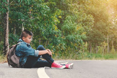 Asian children be tired after backpacking in nature background Stock Image