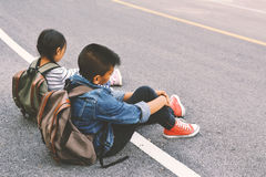 Asian children be tired after backpacking in nature background Royalty Free Stock Photos