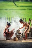 Asian children boy and girl are cooking in the Kitchen of the Co Stock Image