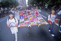 Asian children carrying multi-national flag at Columbus Day Parade, New York City, New York Royalty Free Stock Photography