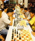Asian children, chess compete, intelligence sport Royalty Free Stock Photos