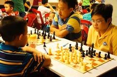 Asian children, chess compete, intelligence sport Stock Photo