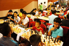 Asian children, chess compete, intelligence sport Royalty Free Stock Photo