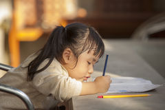 Asian children doing school home work royalty free stock image