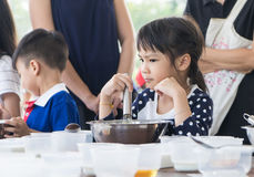 Asian children enjoying educational cooking class Stock Photography