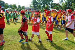 Asian children, football, summer, kid, physical education, socce Royalty Free Stock Image