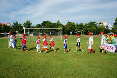 Asian children, football, summer, kid, physical education, socce Royalty Free Stock Photo