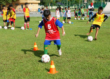 Asian children, football, summer, kid, physical education, socce Royalty Free Stock Photography
