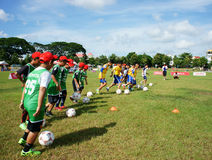 Asian children, football, summer, kid, physical education, socce Royalty Free Stock Images