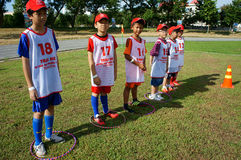 Asian children, football, summer, kid, physical education, socce Royalty Free Stock Photos