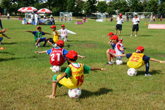 Asian children, football, summer, kid, physical education, socce Stock Images