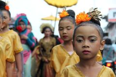 Asian children in gold dresses royalty free stock photo
