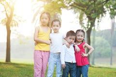 Asian children group portrait outdoors. stock image
