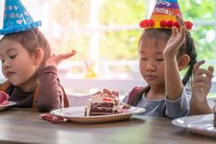 Asian children happy eating her birthday cake in party royalty free stock image