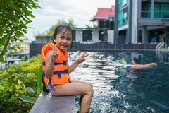 Asian children happy smiling face in sport water pool stock images