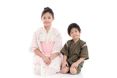 Asian children in Japanese Traditional Dress sitting Stock Photos