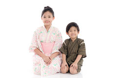 Asian children in Japanese Traditional Dress sitting Stock Image