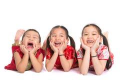 Asian children lying on floor Royalty Free Stock Image