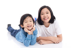 Asian children lying on white background isolated Stock Photo