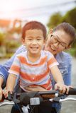 Asian children and mother happiness emotion riding bicycle in home village royalty free stock images
