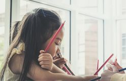 Asian children painting in Art class with teacher, for creati. Asian children is painting in Art class with teacher, for creativity educational concept stock photo