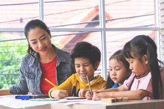 Asian children painting in Art class with teacher, for creati. Asian children is painting in Art class with teacher, for creativity educational concept stock photos