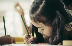 Asian children painting in Art class with teacher, for creati. Asian children is painting in Art class with teacher, for creativity educational concept royalty free stock photos