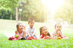 Asian children picnics outdoor. Stock Photo