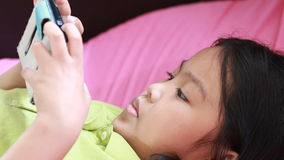 Asian children play games mobile stock video