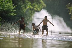 Asian children play soccer in the river,Sport plays an important. Role in rural and regional Thailand,Sport are the predominantly or exclusively played in rural royalty free stock image