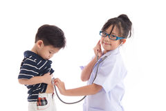 Asian children playing as doctor and patient Stock Images