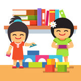 Asian children playing building tower together Royalty Free Stock Images
