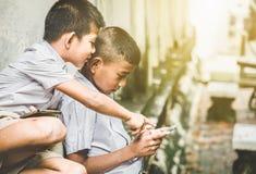 Asian children in rural areas enjoy their peaceful local life. Asian children in rural areas enjoy their peaceful local life royalty free stock images