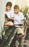 Asian children in rural areas enjoy their peaceful local life. Asian children in rural areas enjoy their peaceful local life stock image
