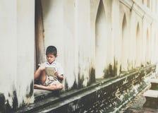 Asian children in rural areas enjoy their peaceful local life. Asian children in rural areas enjoy their peaceful local life royalty free stock photo