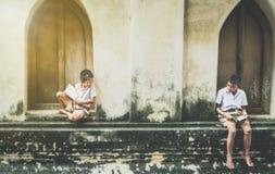 Asian children in rural areas enjoy their peaceful local life. Asian children in rural areas enjoy their peaceful local life royalty free stock image