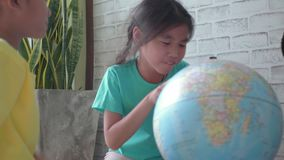 Asian children`s learning about geography. stock video