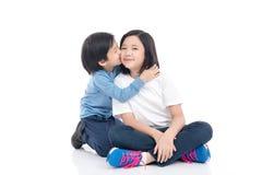 Asian children sitting on white background Stock Photo
