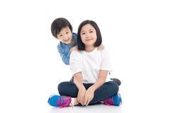 Asian children sitting on white background Royalty Free Stock Photo